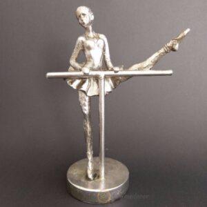 ballerina sculpture on a stand