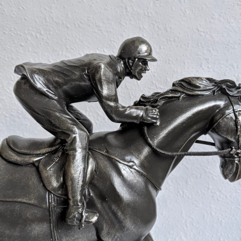 Add a little touch of modern style to your home with this Man Riding Horse Bronze Resin Statue. Product Specifications: Description: Man Riding Horse Bronze Resin Statue Material: Polyresin Size: L33 x W11 x H26 cm Color: Bronze (As pictured) Type: Horse Figurine