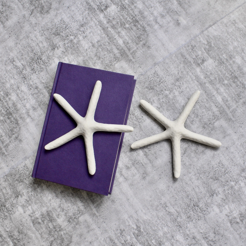 Add a little touch of coastal-inspired decor to your home with the Coastal White Starfish Decor Ornament - Set of 2. Product Features: Stunning Coastal White Starfish Decor Ornament - Set of 2 Made of ceramic Perfect to keep on hallway table, console or study table with or without other home accents Compliments Hamptons and Coastal theme of decor Product Specifications: Material: Ceramic Size : 18 x 18 x 3cm Color: White (As Pictured)