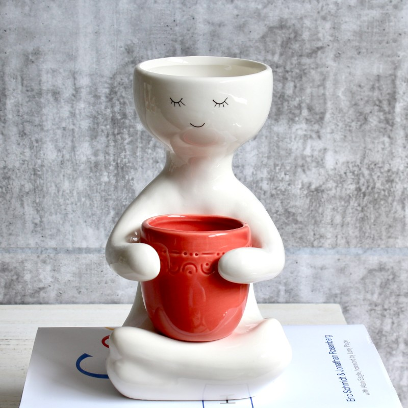 Sitting People Holding A Pot Planter