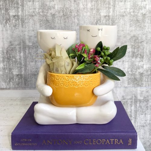 Sitting People Duo Holding A Pot Planter