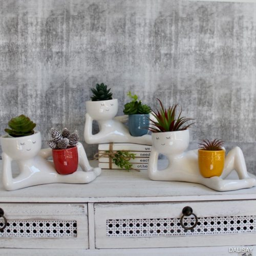 Relaxing Person Holding a Pot Planter